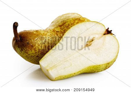 Single abate fetel pear next to a half of pear isolated on white. poster
