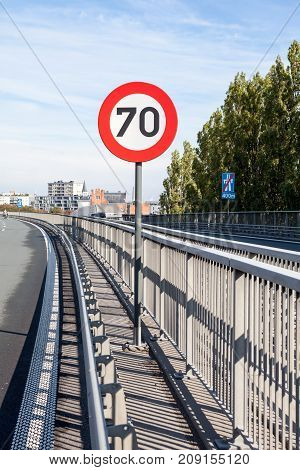 This railing is flying over from Ghent and speed traffic sign