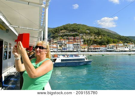 Paxos Corfu Greece - October 1 2017 : Lady taking a selfie in Paxos harbour