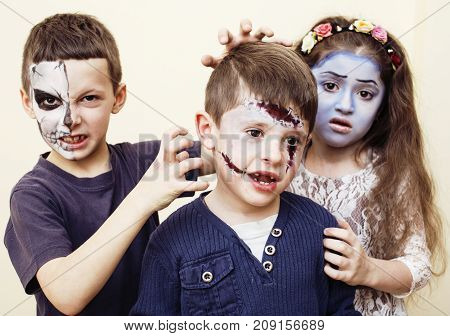 zombie apocalypse kids concept. Birthday party celebration facepaint on children dead bride, scar face, zombie skeleton together close up makeup emotional posing. halloween close up
