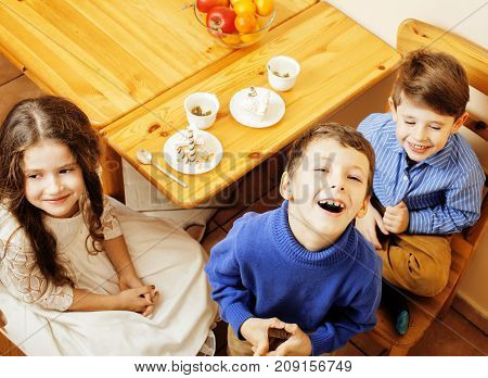 little cute boys eating dessert on wooden kitchen. home interior. smiling adorable friendship together forever friends, lifestyle people concept close up