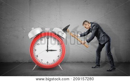 A businessman fails to smash a large red alarm clock because his hammer breaks. Avoid office slavery. Start your business. Fight for flexible hours.