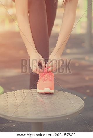 Sporty Woman Binds The Shoes