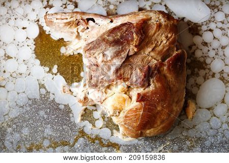 Cold Roast Pork Surrounded By Congealed Fat From Above.