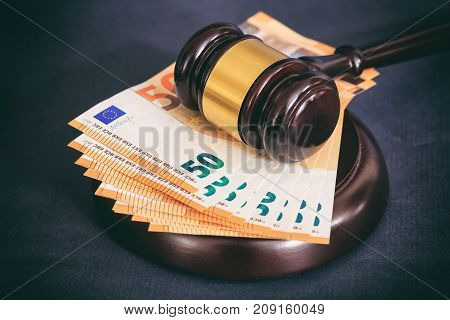 Law Or Auction Gavel And Euro Banknotes On Black Background