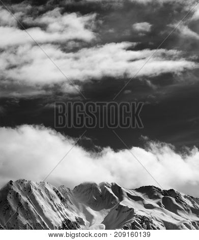 Black and white winter snow mountains at nice sun evening. Caucasus Mountains. Georgia region Svaneti.