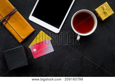christmas 2018 sales for online gift buying with credit card and pad on black desk background top view mock-up