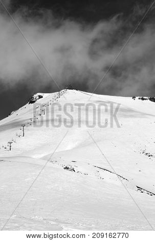 Black And White View On Ski Resort And Chair-lift At Sunny Winter Day