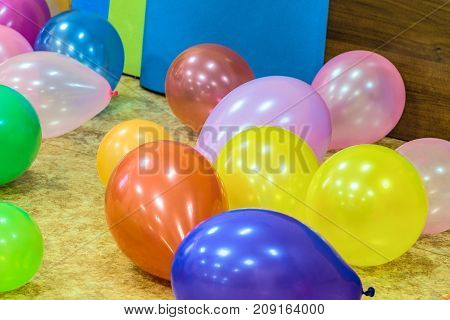 Festive colored rubber balloons on the floor
