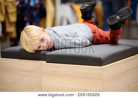 Tired Little Boy During Shopping With Parents