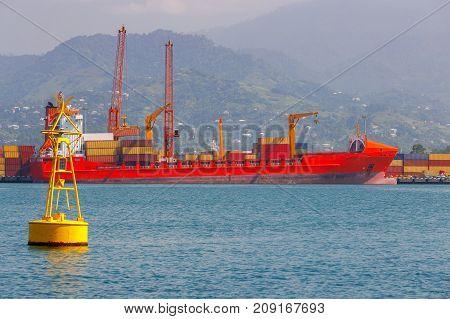 A large container ship under loading near the pier. Georgia. Batumi. Adjara.