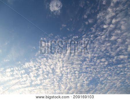 beautiful clouds against blue sky . Photo of abstract background