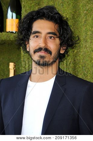 Dev Patel at the 8th Annual Veuve Clicquot Polo Classic held at the Will Rogers State Historic Park in Pacific Palisades, USA on October 14, 2017.