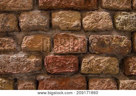 Brick wall of red brick. Old red brick masonry. Stone wall.