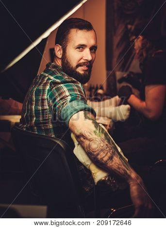 Man at tattoo artist session