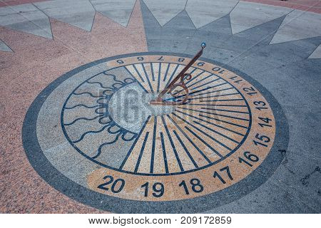 Sundial in the square at the day