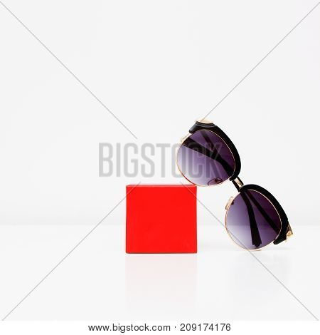 Minimal Style. Minimalist Fashion Photography. Fashion Summer Is Coming Concept. Sunglasses On A Whi
