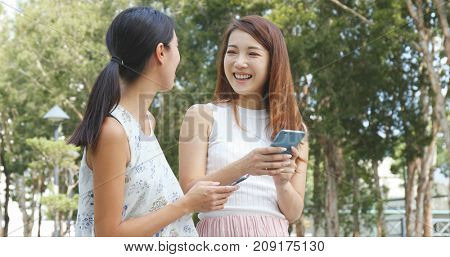 Friends talking with cellphone at outdoor