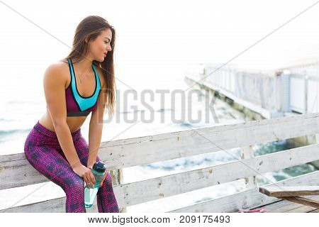 Woman Working Out At The Beach