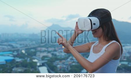Woman playing game on VR device