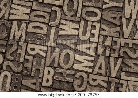 background of random vintage letterpress printing blocks, platinum toned black and white image