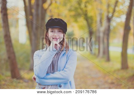 Woman In Blue Coat Have A Rest In Autum Park