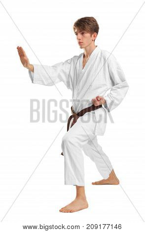 Young guy karatek with a brown belt on a white isolated background coaches punches with his hands