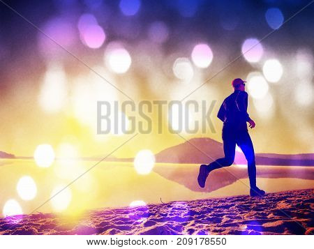 Tall Fit Man Running Along The Sea Shore In Morning. Healthy Male Jogging On Lake Beach.