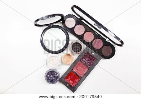 Set for make-up, mirror, palette, isolated on white background. The concept of beauty.