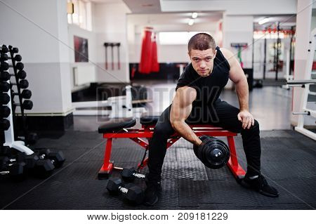 Young Man Doing Exercises And Working Hard In Gym And Enjoying His Training Process.