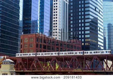 Elevated train passing by skyscrapers in downtown Chicago
