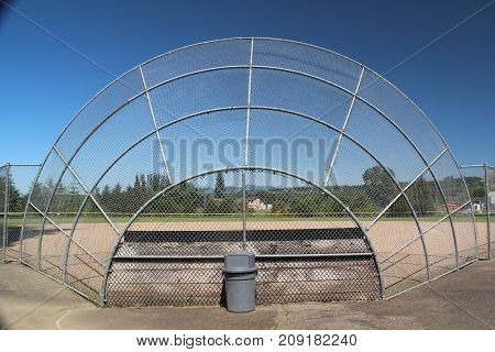 Unused symmetrical baseball backstop during summer break.