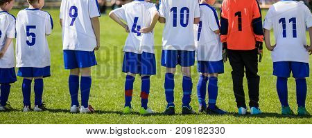 Children soccer players in a row. Football match for children. Training and football soccer tournament. Children stand in line