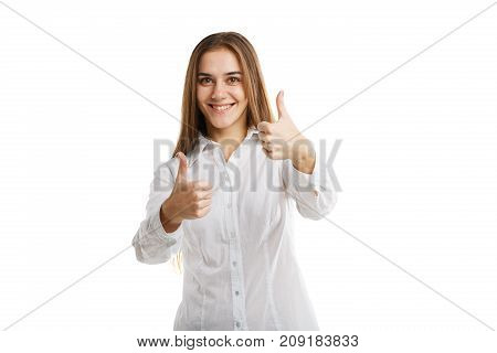 Smiling cute girl posing on the camera in photo studio with long brown hair isolated on a white background. Close-up of attractive girl.
