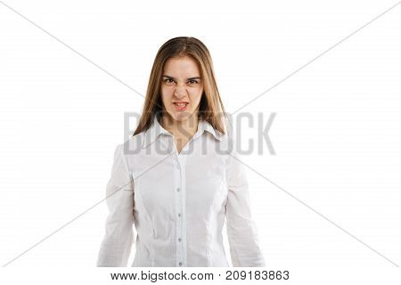 Attractive young girl posing on the camera in studio and showing emotions of evil isolated on a white background. Beautiful girl with a long hair. Close-up of woman.