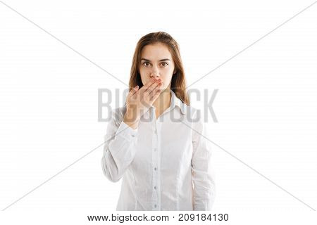Attractive young girl posing on the camera in studio and shout mouth isolated on a white background. Beautiful girl with a long hair. Close-up of woman.