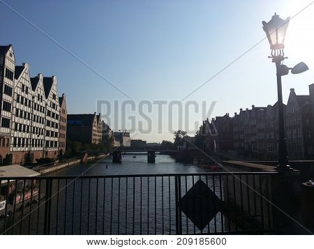 View from the bridge to the river in Gdansk and the embankment