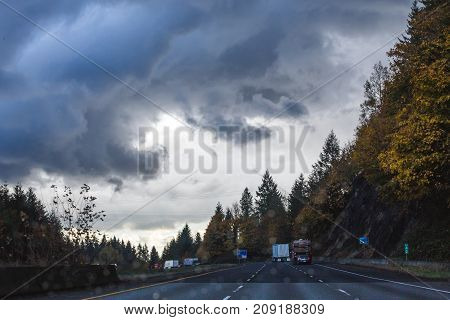 Dramatic Clouds Over Highway In Fall