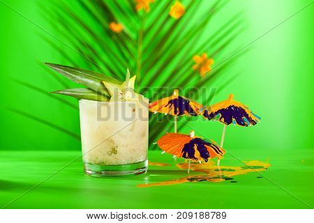 Summer Tropical Cocktail - Mai Tai Cocktail. Summer Beach Cocktail Concept. Tropical Leaves on Background