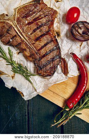 Gourmet Grill Restaurant Steak Menu - T-Bone Beef Steak on Wooden Background. Black Angus Prime Beef Steak. Beef Steak Dinner. Top VIew