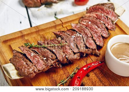 Gourmet Grill Restaurant Beef Steak Menu - Skirt Steak on Wooden Plate. Black Angus Beef Steak. Beef Steak Dinner