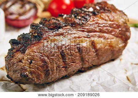 Gourmet Grill Restaurant Steak Menu - Tri-Tip Beef Steak on Wooden Background. Black Angus Prime Beef Steak. Beef Steak Dinner