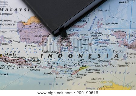 Personal planner notes of a traveller planning a trip to Indonesia with a close up map of Indonesia islands.