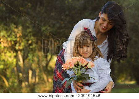 Little Girl Wants To Give Her Mother A Beautiful Bouquet Of Flowers