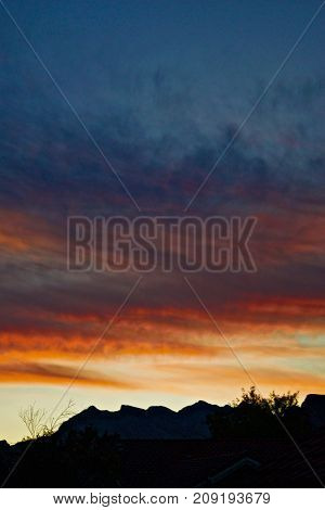 Silhouette Mountain against a Colorful Sunset Sky