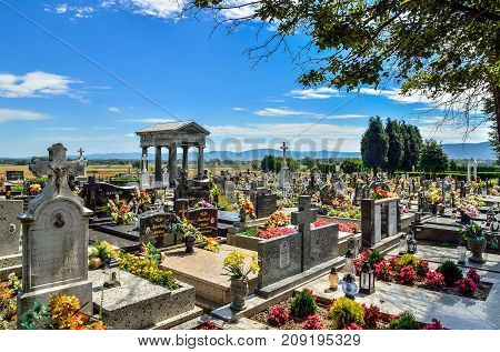 WILAMOWICE POLAND - AUGUST 5 2017: A cemetery with an ancient tombstone in Wilamowice Poland.