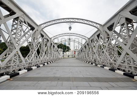 SINGAPORE - OCTOBER 13 2017: Anderson footbridge across the Singapore River was opened in 1910.
