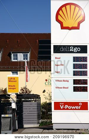 NIEDER-OLM, GERMANY - OCTOBER 14: The pre-column of a shell gas station with an air and water column next door on October 14 2017 in Nieder-Olm.