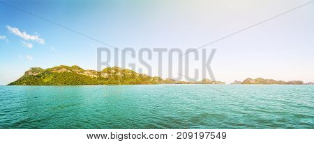 Panorama beautiful natural landscape front of the Mu Ko Ang Thong island National Marine Park on the sea under bright blue sky and sunlight in summer is a famous attractions in Surat Thani Thailand