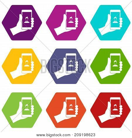 Hand holding smartphone with photo icon set many color hexahedron isolated on white vector illustration